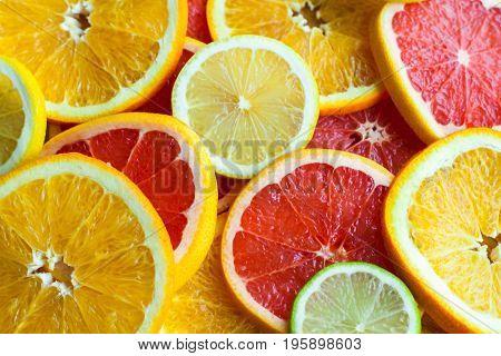 Citrus fruits. Fresh fruits. Mixed fruits background. Healthy eating, dieting. Background of healthy fresh fruits. Fruit salad - diet, healthy breakfast. pomegranate, lemon