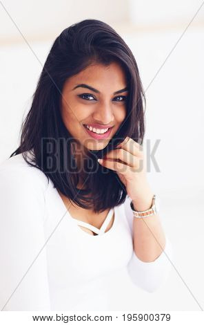 portrait of beautiful young indian woman on white