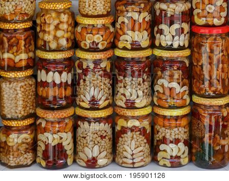 Beautifully decorated jars with honey and nuts as traditional souvenir