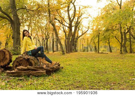 Beautiful young woman enjoying the autumn in the forest.