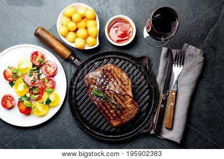 Grilled Beef Steak On Grill Pan Served With Tomato Salad, Potatoes Balls And Wine. Barbecue, Bbq Mea
