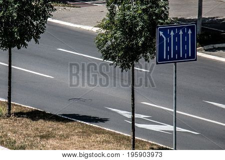 Street sign shows the available ways blue table