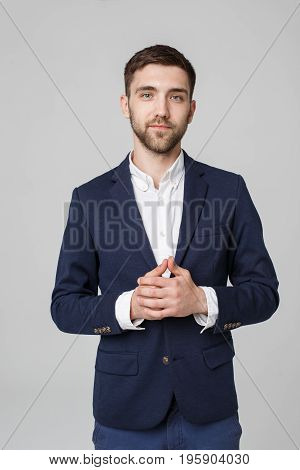 Business Concept - portrait young successful businessman posing over dark background. Copy space.