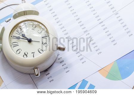 Clock, Files And On A Market Report