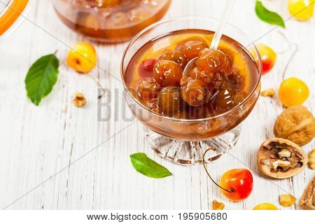 Cherry Jam with Nuts. Azerbaijan Cuisine White Cherry Preserves. Selective focus.