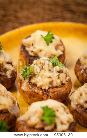 Homemade Vegetarian Stuffed Mushrooms with Cheese and Breadcrumbs. Selective focus.