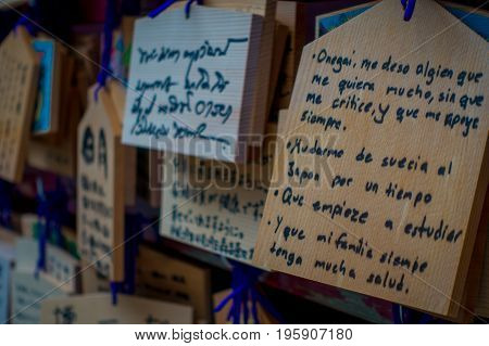 HAKONE, JAPAN - JULY 02, 2017: EMA at Kiyomizu-dera Temple. EMA are small wooden plaques on which Shinto worshippers write their prayers or wishes.