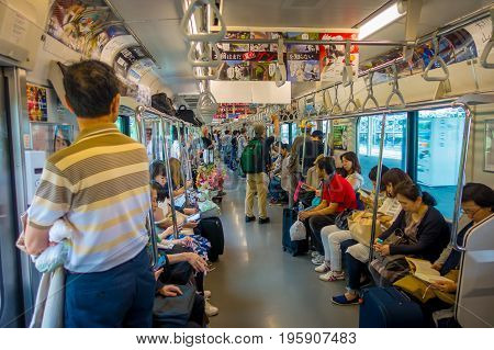 HAKONE, JAPAN - JULY 02, 2017: Unidentified people at the interior of train during rainy and cloudy day.
