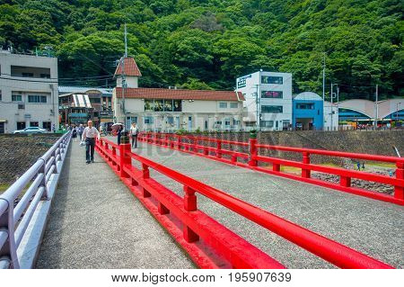 HAKONE, JAPAN - JULY 02, 2017: Red bridge over the river at Odawara, transition point to Hakone.