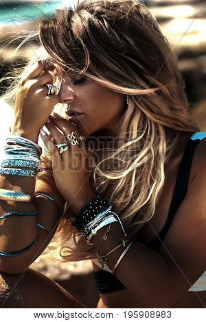 Portrait Of Blonde Woman With Jewelry.