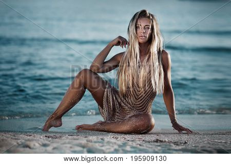 Sexy Blonde Lady On The Beach.