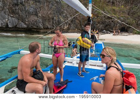 EL NIDO, PALAWAN, PHILIPPINES - JANUARY 19, 2017: Foreigners from different countries doing island hopping in El Nido.