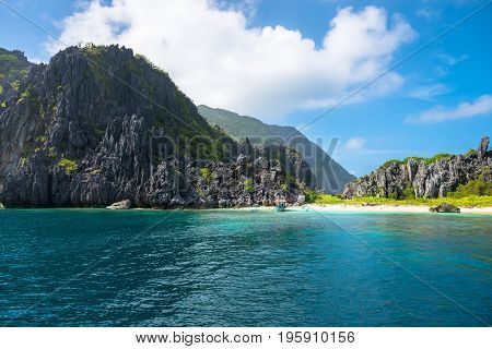 EL NIDO, PALAWAN, PHILIPPINES - JANUARY 19, 2017: Huge sharp rocks, beautiful beach and tropical weather in El Nido