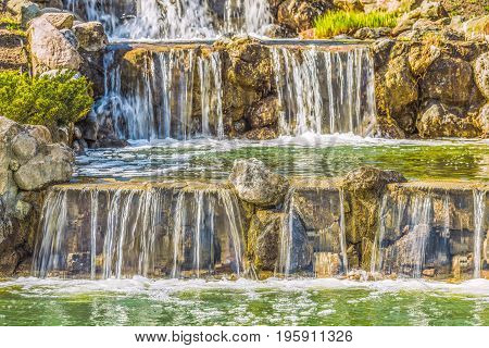 Cascade waterfall in the landscape park Mezhyhirya near Kiev.