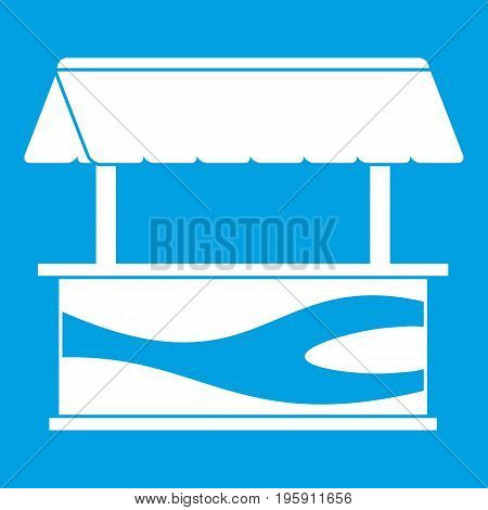 Market stall with awning icon white isolated on blue background vector illustration