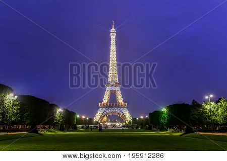 Paris, France - May 16, 2017: The iconic Eiffel Tower on a drizzly evening from the Champ de Mars in Paris France.