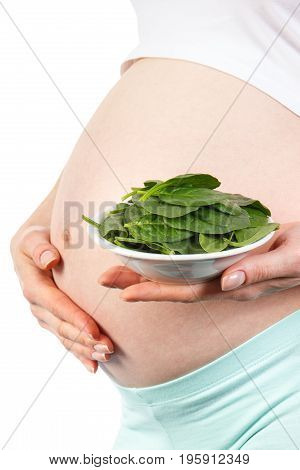 Pregnant Woman With Green Spinach, Healthy Nutrition Containing Iron During Pregnancy