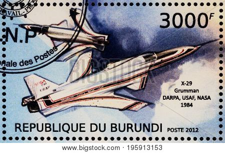 Moscow Russia - July 17 2017: A stamp printed in Burundi shows American experimental supersonic aircraft Grumman X-29 with forward-swept wing (1984) series