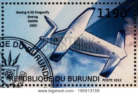 Moscow Russia - July 17 2017: A stamp printed in Burundi shows experimental unmanned aerial vehicle Boeing X-50 Dragonfly (2003) series