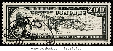 Moscow Russia - July 18 2017: A stamp printed in Comoros shows French aviator Louis Bleriot and his airplane Bleriot XI series
