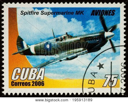 Moscow Russia - July 17 2017: A stamp printed in Cuba shows old British single-seat fighter aircraft of World War II - Spitfire Supermarine MK series