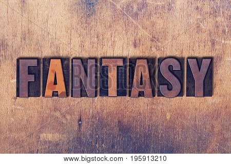 Fantasy Theme Letterpress Word On Wood Background
