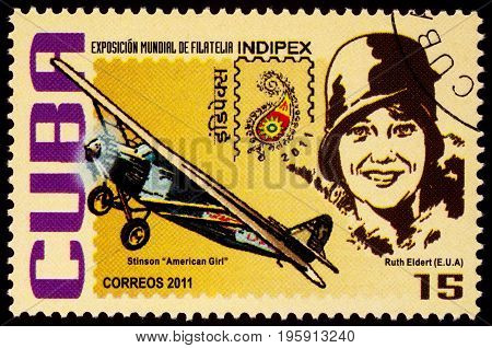 Moscow Russia - July 18 2017: A stamp printed in Cuba shows American pilot Ruth Elder and her airplane Stinson 'American Girl' series
