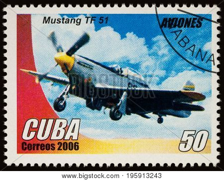 Moscow Russia - July 17 2017: A stamp printed in Cuba shows old American fighter aircraft Mustang TF51 series