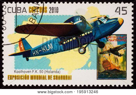 Moscow Russia - July 18 2017: A stamp printed in Cuba shows old Dutch passenger airplane Koolhoven F.K.50 (1930s) series