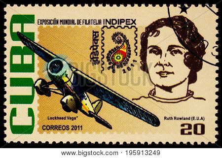 Moscow Russia - July 18 2017: A stamp printed in Cuba shows American aviation pioneer Ruth Rowland and her airplane Lockheed Vega series