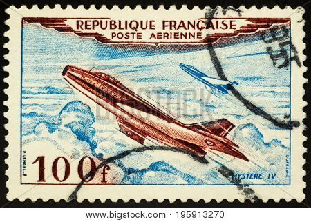 Moscow Russia - July 19 2017: A stamp printed in France shows military aircraft Mystere IV (fighter-bomber 1952) circa 1954