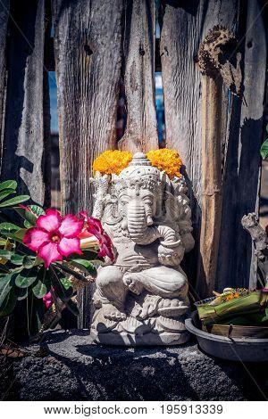 Small statue of hindu god Ganesha in tropical island Nusa Lembongan, Indonesia.