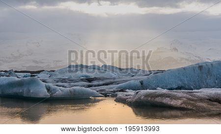Sun Light Reflecting On Iceberg Glacier Lagoon, Jokusalon