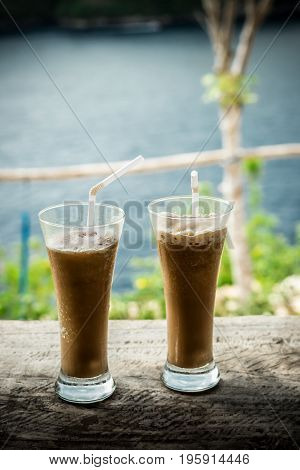 Glasses Of Cold Coffee On Wood outside. Tropical island, Indonesia.