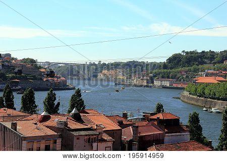 View of the city of Porto along the river Douro and the bridge Dom Luis from Gaia Porto, Portugal