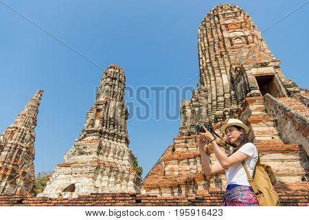 Young Asian Woman Taking Pictures