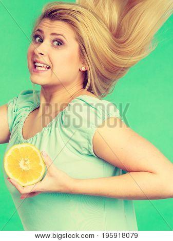 Woman Holding Fruit Lemon Half