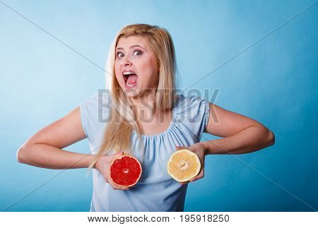 Woman Holding Red And Green Grapefruit