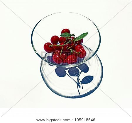 Bright red cherries on a transparent plate