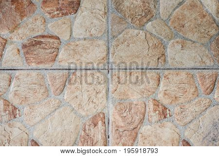 Brown stone tile texture surface. Square marble pattern