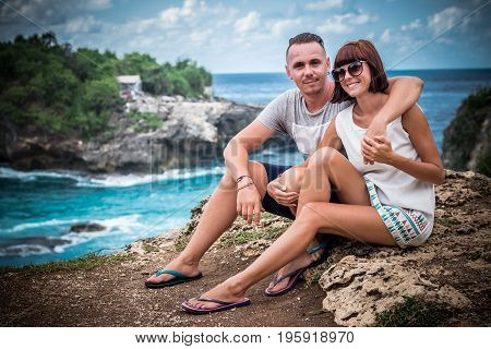 Attractive young happy romantic couple on the tropical island Nusa Lembongan, Indonesia. Happy honeymoon during their vacation in Asia.