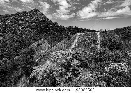 Bold black and white mountain jungle landscape of a rocky ridge on the Wu Liao Jian hiking trail in Taiwan