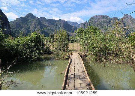 Wooden bridge, Wooden bridge with the rainy season in Vang Vieng, Laos.Wood bridge for explore nature of lao.