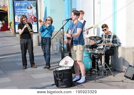 St. Petersburg, Russia - July 13 2017:  Street music band-group stands close to Nevsky prospect. Summer day.