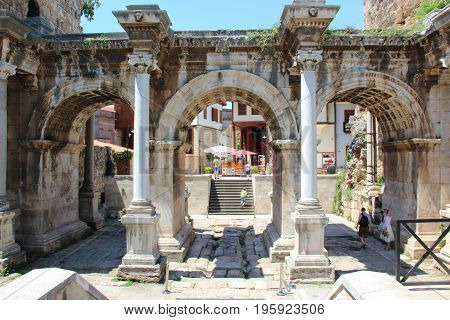 Antalya, Turkey - 1 Jun 2017: The ancient triumphal arch of the Emperor Hadrian in the city center in front of the entrance to the old town - Kaleici.