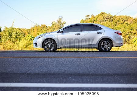 Phuket, Thailand - June 16 : Toyota Corolla Altis Parking On The Asphalt Road In Phuket On June 16,