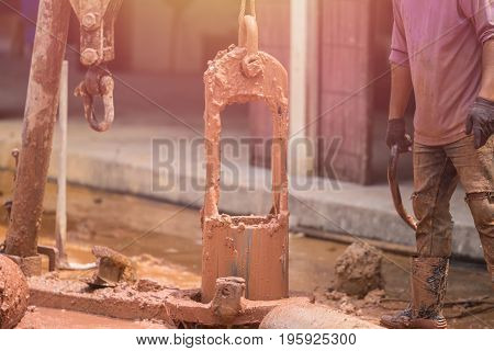 Worker Installing Wet-process Bored Pile For Outside Public Construction