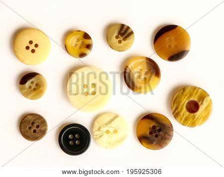buttons of many colors on black background