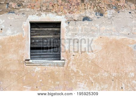 Boarded Up Window On Yellow Plaster Wall