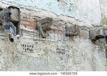 Old Wooden Beams In Ruined Brick Wall Of Abandoned Building